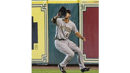 Pirates&#039; Garrett Jones catches a ball for an out against the Houston Astros in the fourth inning.