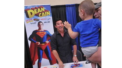Dean Cain, who played Superman in the TV series &quot;Lois and Clark,&quot; has a big smile for 2-year-old Brycen Bedard of Pittsburgh at the Steel City Con in Monroeville Convention Center.