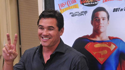 "Dean Cain, who played Superman in the TV series ""Lois and Clark,"" flashes a victory sign to people who came to get his autograph at Steel City Con."
