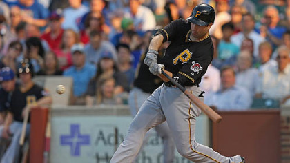 The Pirates' Neil Walker hits a grand slam home run in the first inning against the Chicago Cubs at Wrigley Field.