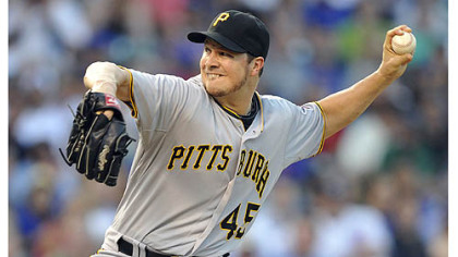 Pittsburgh Pirates' Erik Bedard  pitches against the Chicago Cubs during the first inning of a baseball game Monday, July 30, 2012, in Chicago.