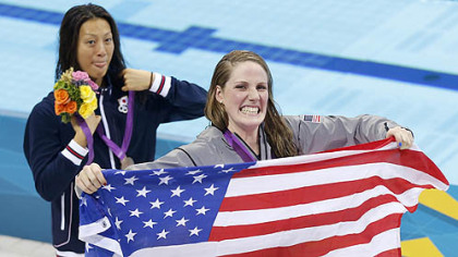 United States gold medalist Missy Franklin holds a national flag at a medal ceremony with Japan&#039;s silver medalist Aya Terakawa after the women&#039;s 200-meter freestyle swimming semifinal Monday.