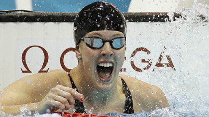 United States' (and Pittsburgh's) Allison Schmitt celebrates her gold medal win in the women's 200-meter freestyle swimming final.