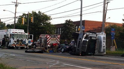 Three people were trapped when a truck overturned onto a car in Ross early Wednesday morning.