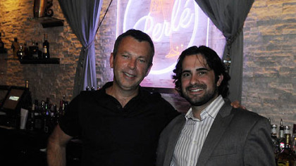 Yves Carreau, left, who created the restaurants Sonoma, Seviche and NOLA, stands with his business partner Peter Landis at Perle in Market Square, their new nightclub that has champagne on tap.