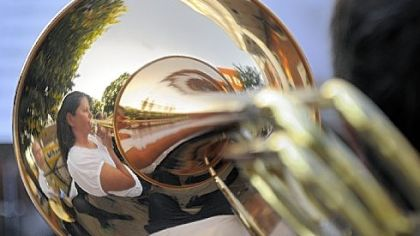 Tracey Sepe plays the trombone with the Penn-Trafford Community Band on Sunday.