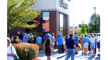 Patrons swarm Chick-fil-A at dinnertime Wednesday along Route 228 in Cranberry.