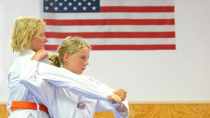 Georgia Berk, 13, practices judo today with her mother, Katherine, of Baldwin Borough, at Kim's Martial Arts & Fitness in Brentwood.
