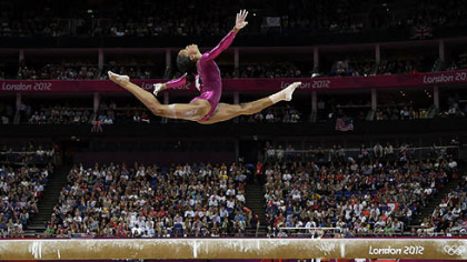 U.S. gymnast Gabrielle Douglas performs on the balance beam during the artistic gymnastics women&#039;s individual all-around competition at the 2012 Summer Olympics.