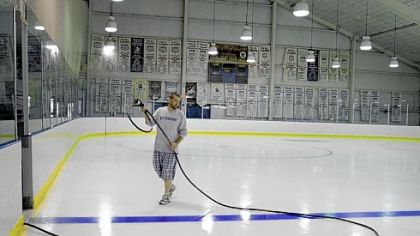 Chadd John of Lower Burrell does some regular ice maintenance Thursday at the Valley Sports Complex. The Sports Complex is expecting some upgrades in the near future, including new lighting and signage.