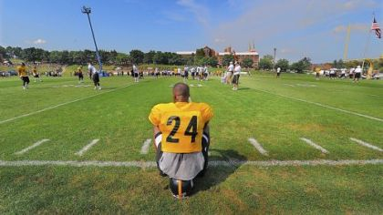 Ike Taylor takes a break during workouts.
