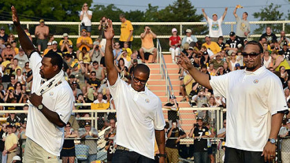 From left, Joey Porter, Willie Parker and Marvel Smith wave to the crowd Friday night at Latrobe Stadium as they retire as Steelers.