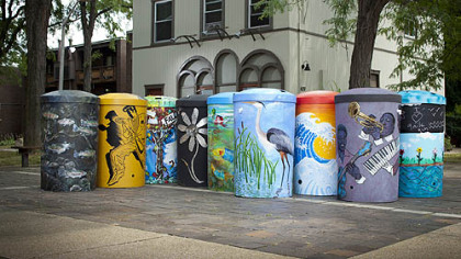 Rain barrels painted by local artists have been installed around the city as part of StormWorks Rain Barrels on Parade project.