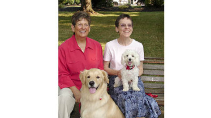 Sister Pat Montini, left, with her golden retriever Luca and  Sister Sharon Costello with Buster, the Maltese.