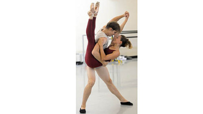 "Nicholas Coppula and Alexandra Kochis rehearse ""Step Touch."""