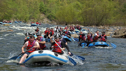 Rafters paddle down the Lehigh River through the Lehigh River Gorge in Jim Thorpe.