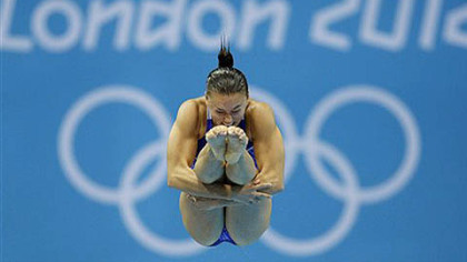 Kennedy native Cassidy Krug competes during the women&#039;s 3-meter springboard diving semifinal today.