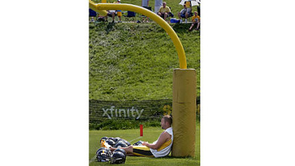 Ben Roethlisberger finds a place to try to catch a break from the heat and humidity Saturday at the Saint Vincent College training camp.