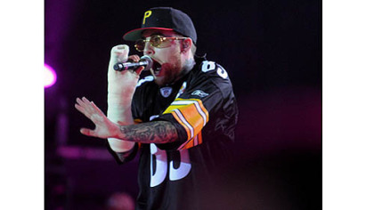 Mac Miller, in a cast from breaking his arm, returns to Pittsburgh and performs at First Niagara Pavilion with fellow Pittsburgh rap artist Wiz Khalifa.