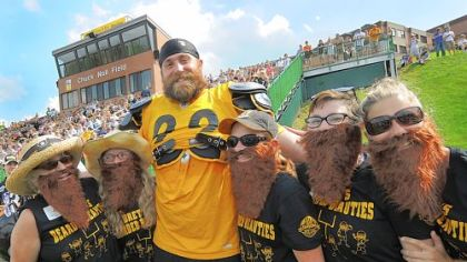 "Brett Keisel poses with ""Brett's Bearded Beauties"" during afternoon workouts yesterday at Steeler Training Camp. Share your own training camp moments with the Steeler Nation at www.post-gazette.com/yourphotos"