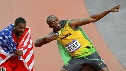 Gold medalist Jamaica's Usain Bolt celebrates with bronze medalist Justin Gatlin of the U.S. after winning the men's 100m final.