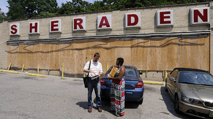 Sheraden community coordinator Steve Novotny and Tammy Thompson of NeighborWorks Western PA meet at the old supermarket in Sheraden before going door-to-door giving out information on community issues, including foreclosures and other housing concerns.