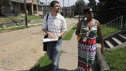 Steve Novotny, the Sheraden Community coordinator, and Tammy Thompson of NeighborWorks Western PA, go door-to-door giving out information in Sheraden on issues in the community, including foreclosures and other housing issues.
