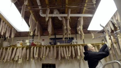 Sopressata is hung to dry in the Panellas' Prospect basement.
