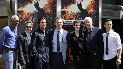 """The Dark Knight Rises"" director Christopher Nolan, fourth from left, poses Saturday with cast members at his hand and footprint ceremony at Grauman's Chinese Theatre in Los Angeles."