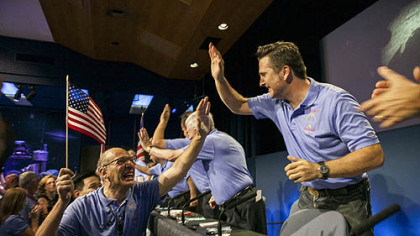 Mars Science Laboratory Curiosity team members celebrate after the successful landing of the Curiosity rover on the surface of Mars at NASA's Jet Propulsion Laboratory in Pasadena, Calif. (AP Photo/Damian Dovarganes)