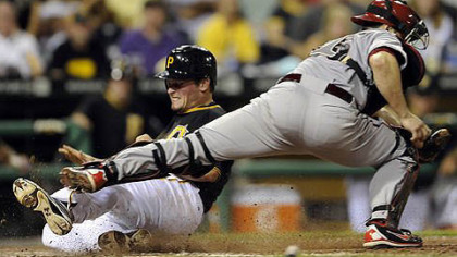 The Pirates' Travis Snyder scores the go-ahead run in the seventh inning Tuesday against the Diamondbacks.