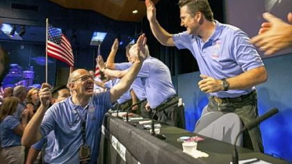 Above, at NASA?s Jet Propulsion Laboratory in Pasadena, Calif., Mars Science Laboratory team members Miguel San Martin, left, and Adam Steltzner celebrate early Monday after the successful landing of the United States? Curiosity rover on the surface of Mars.