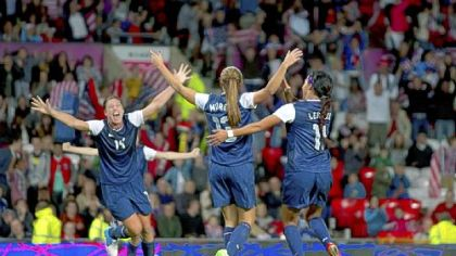Alex Morgan, center, celebrates with Abby Wambach, left, and Sydney Leroux after scoring the winning goal Monday.