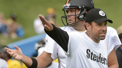 Steelers offensive coordinator Todd Haley gives instruction to quarterback Ben Roethlisberger during afternoon workouts at training camp.