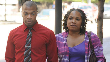 Jordan Miles and his mother, Terez Miles, arrive at the federal courthouse Wednesday morning.