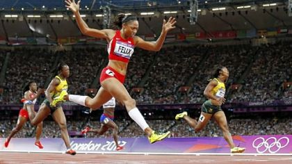 After settling for silver twice, Allyson Felix drives to the finish of her first Olympic gold medal in the women's 200-meter dash Wednesday in London.