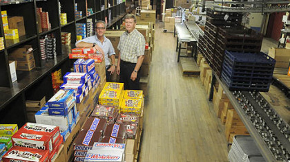 Jon Prince, president of McKeesport Candy Co., and Tom Griffin, executive manager, stand in the warehouse that the company has occupied since 1927. With the advent of the Internet, the company specializes in selling retro, novelty and themed candy.
