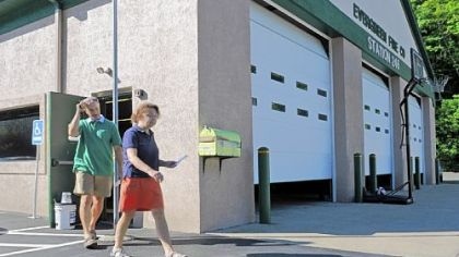 Voters leave the Evergreen Fire Company in Ross after casting their ballots Tuesday in the special election to fill the seat of former state Sen. Jane Orie, who resigned after being convicted of public corruption.
