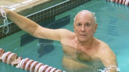 The Rev. Bruce Bryce of Whitehall swims to raise money for improvements to Baldwin Community United Methodist Church.