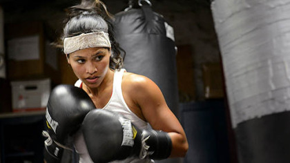 Jennifer Dugwen Chieng hits a punching bag as a part of her daily training routine Tuesday at the Third Avenue Boxing Gym in Downtown Pittsburgh.