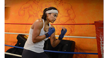 Jennifer Dugwen Chieng shadowboxes Tuesday at the Third Avenue Boxing Gym in Downtown Pittsburgh.