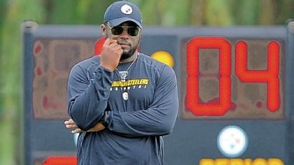 Pittsburgh Steelers head coach Mike Tomlin watches the offense during training camp at St Vincent College in Latrobe.