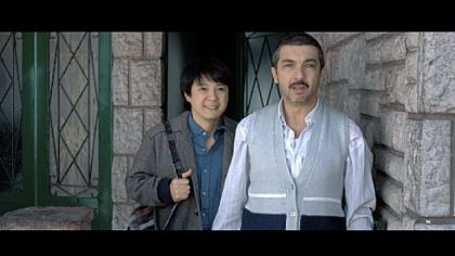 "Despite a language barrier, Huang Sheng Huang, left, and Ricardo Darin develop something of a friendship in ""Chinese Take-Away."""