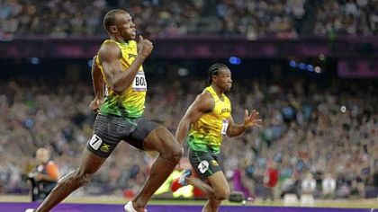 Jamaica's Usain Bolt, left, passes compatriot Yohan Blake as he races to his gold medal finish in the men's 200-meter final.