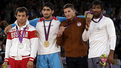 The medalists pose after the men's 60-kg freestyle wrestling competition. From left to right: silver medalist Besik Kudukhov of Russia, gold medalist Toghrul Asgarov of Azerbaijan,  bronze medalist Coleman Scott (from Waynesburg) of the United States and bronze medalist Yogeshwar Dutt of India.