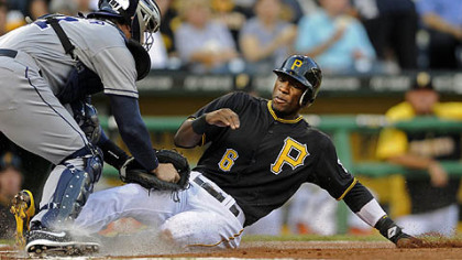 Padres&#039; John Baker tags out Pirates&#039; Starling Marte at home plate in the first inning Friday night at PNC Park.