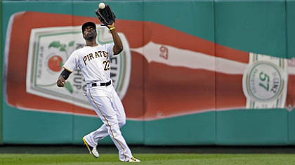 The Pirates' Andrew McCutchen pulls in a fly ball hit by the Padres' Carlos Quentin in the third inning.