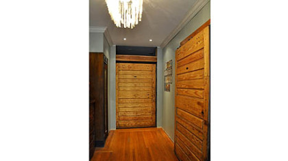 Melissa and Stephen Neely of Point Breeze reused old freezer doors as hanging barn doors.