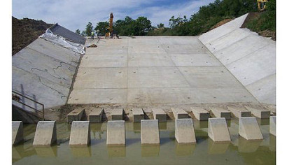 The new $5.1 million dam and spillway at Dutch Fork Lake was recently completed by the state Fish and Boat Commission. The lake should be refilled and restocked with fish by spring.