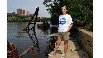 Myrna Newman, executive director of Allegheny Cleanways, stands next to the Monongahela River on Thursday at an old boat launch on the South Side.